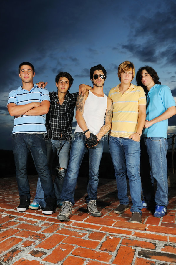 Trendy youth. Portrait of young trendy group of friends standing with attitude royalty free stock images