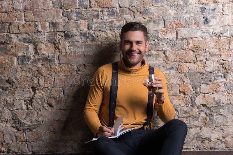 Trendy youthful male posing with joy stock photos