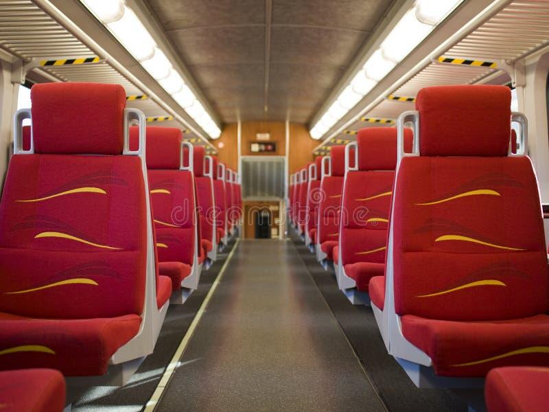 Treno pendolare - carrozza ferroviaria vuota fotografia stock libera da diritti