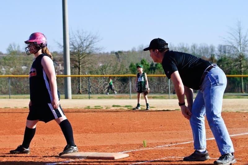 trenowania dziewczyny s softball obrazy royalty free