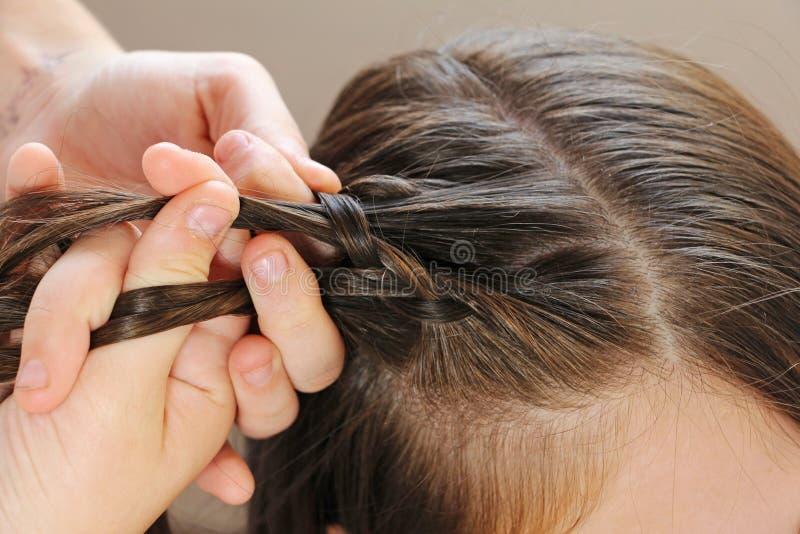 Trenzas del peinado foto de archivo