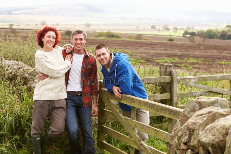 Tres adultos en campo fotos de archivo