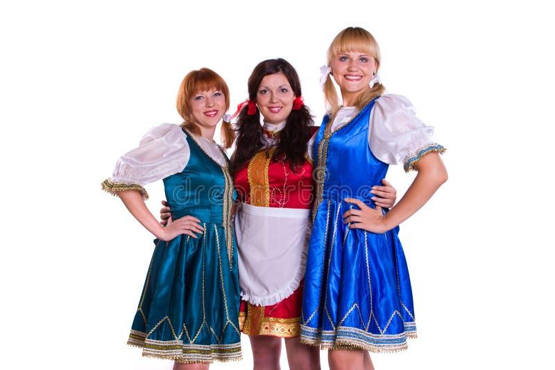 Tres alemanes/mujeres bávaras fotografía de archivo