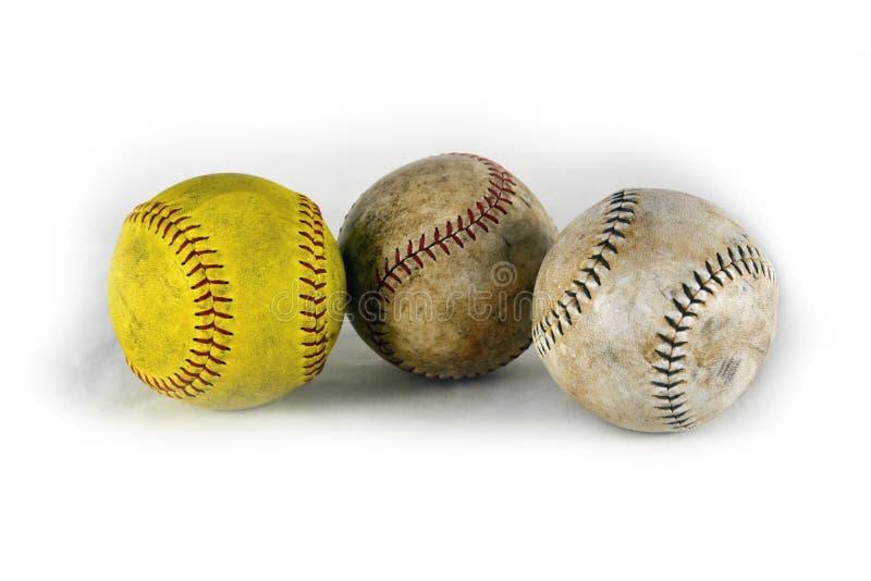 Tres béisboles en fila, después de un buen juego fotografía de archivo libre de regalías