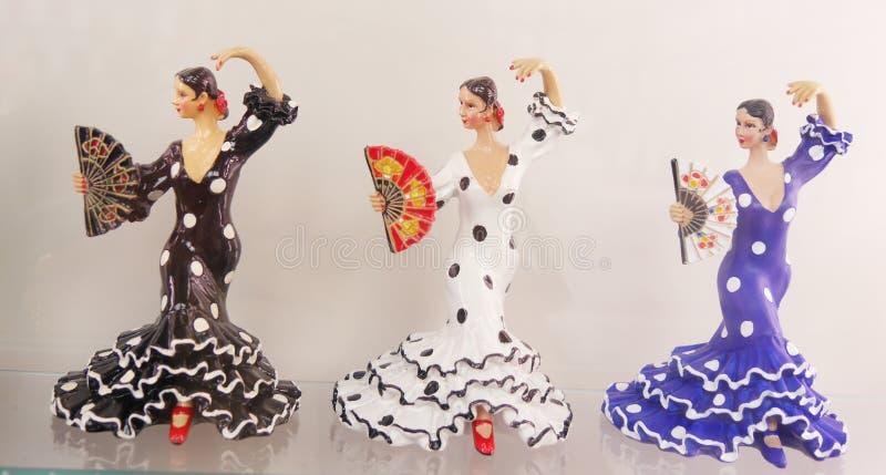 Tres bailarines de sexo femenino ornamentales del flamenco fotografía de archivo