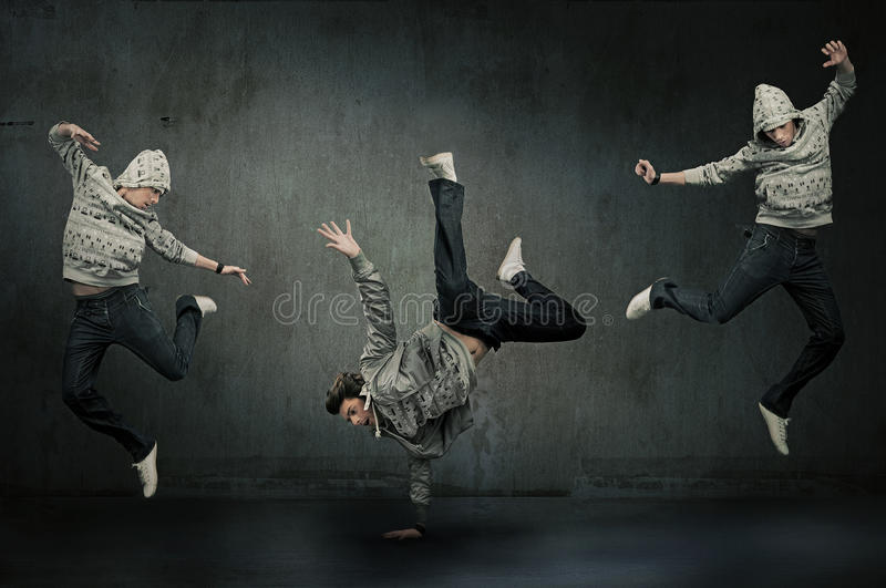 Tres bailarines del salto de la cadera imagenes de archivo