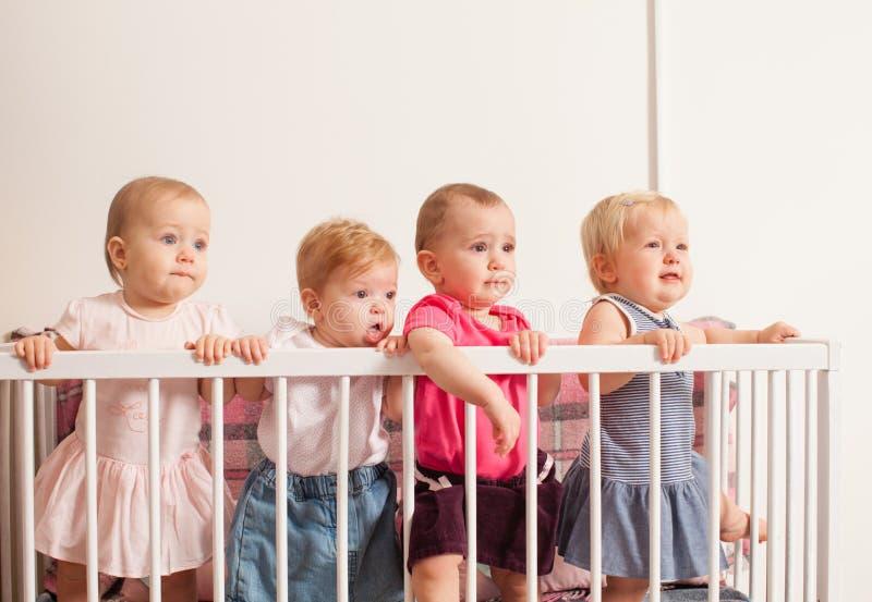 Tres bebés en el pesebre foto de archivo libre de regalías