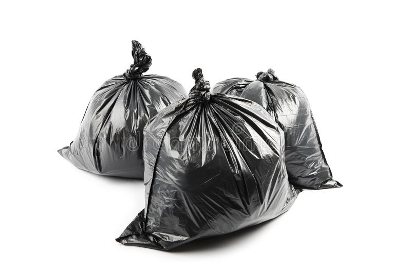 Tres bolsos de basura negros foto de archivo