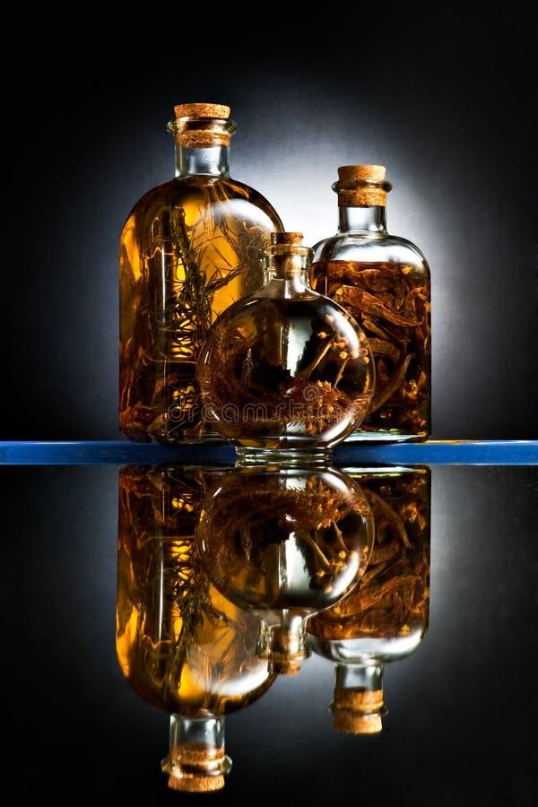 Tres botellas de cristal imágenes de archivo libres de regalías