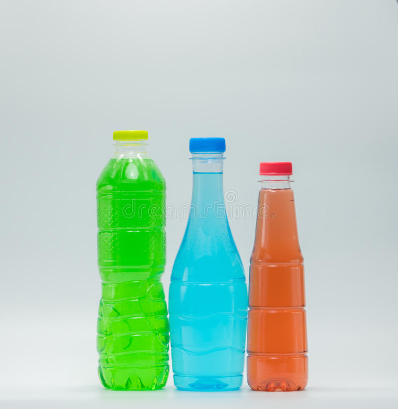 Tres botellas del diseño moderno de refresco imagen de archivo libre de regalías