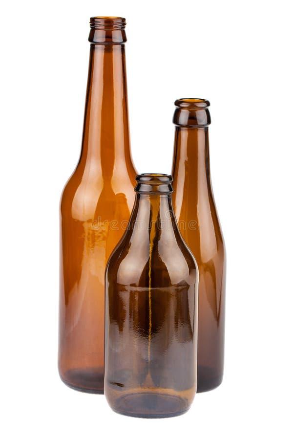Tres botellas marrones vacías foto de archivo libre de regalías