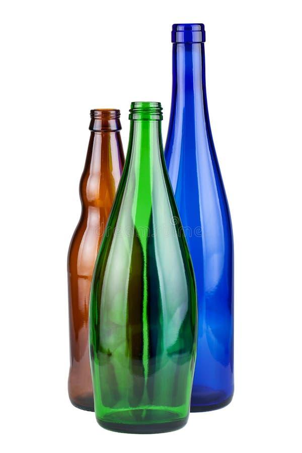 Tres botellas vacías fotos de archivo libres de regalías