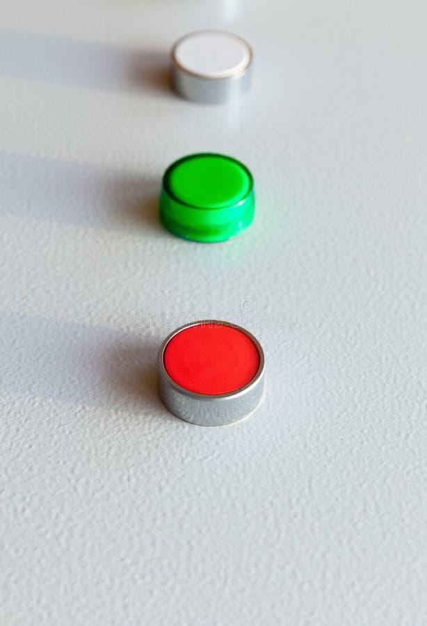 Tres botones industriales en fila imágenes de archivo libres de regalías