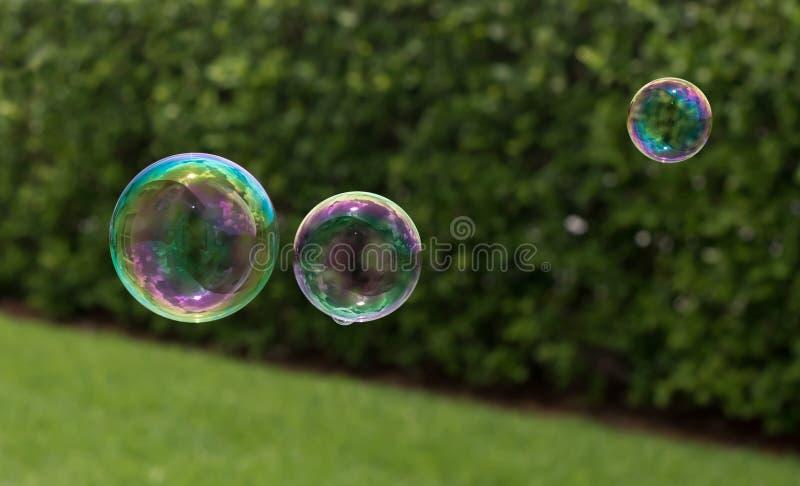 Tres burbujas con la reflexión fotos de archivo