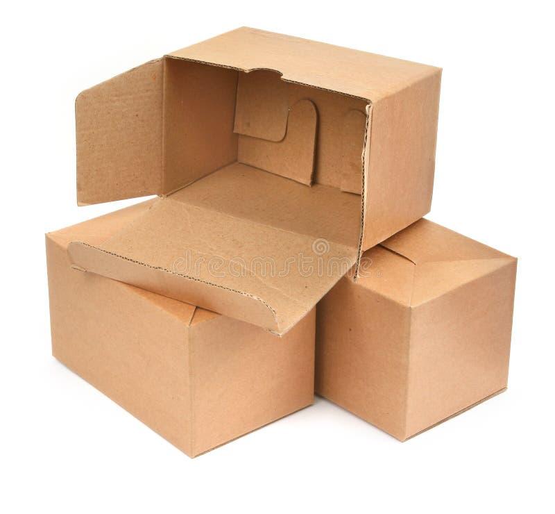 Tres cajas de cartón imágenes de archivo libres de regalías