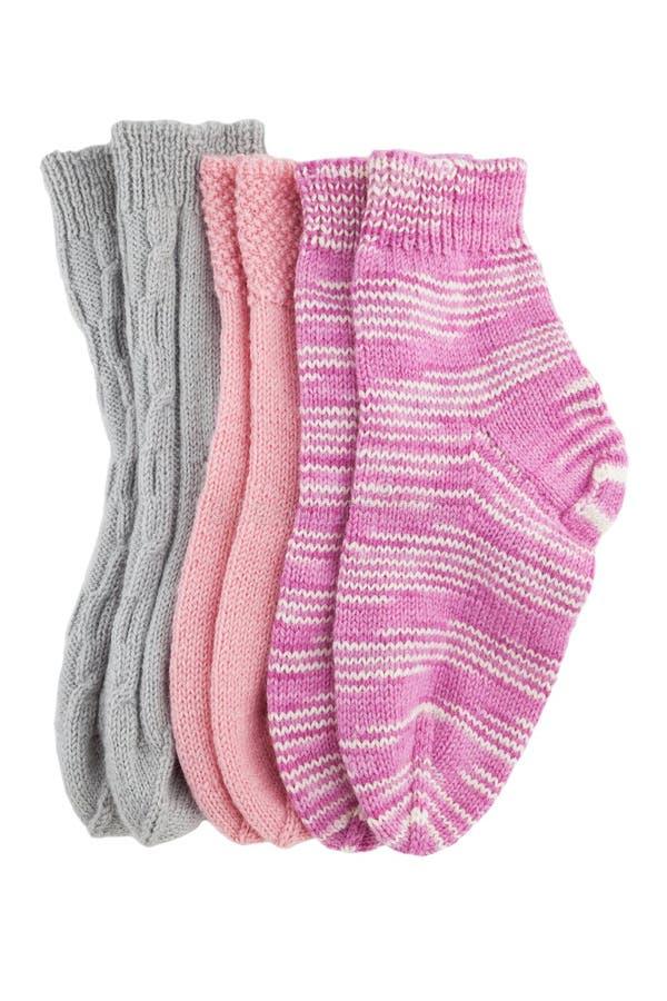 Tres calcetines de las lanas de los pares aislados fotos de archivo libres de regalías