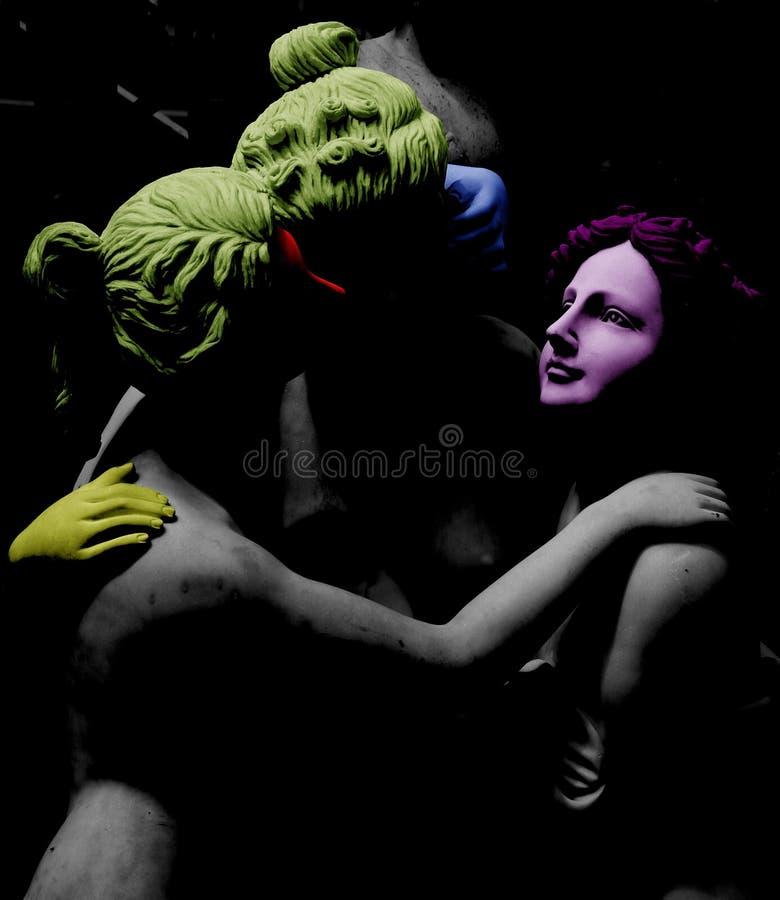 Tres caracteres femeninos en diversos colores fotografía de archivo