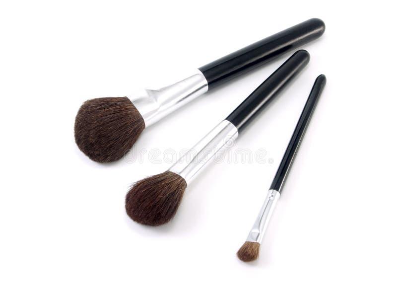 Tres cepillos para el maquillaje fotos de archivo libres de regalías