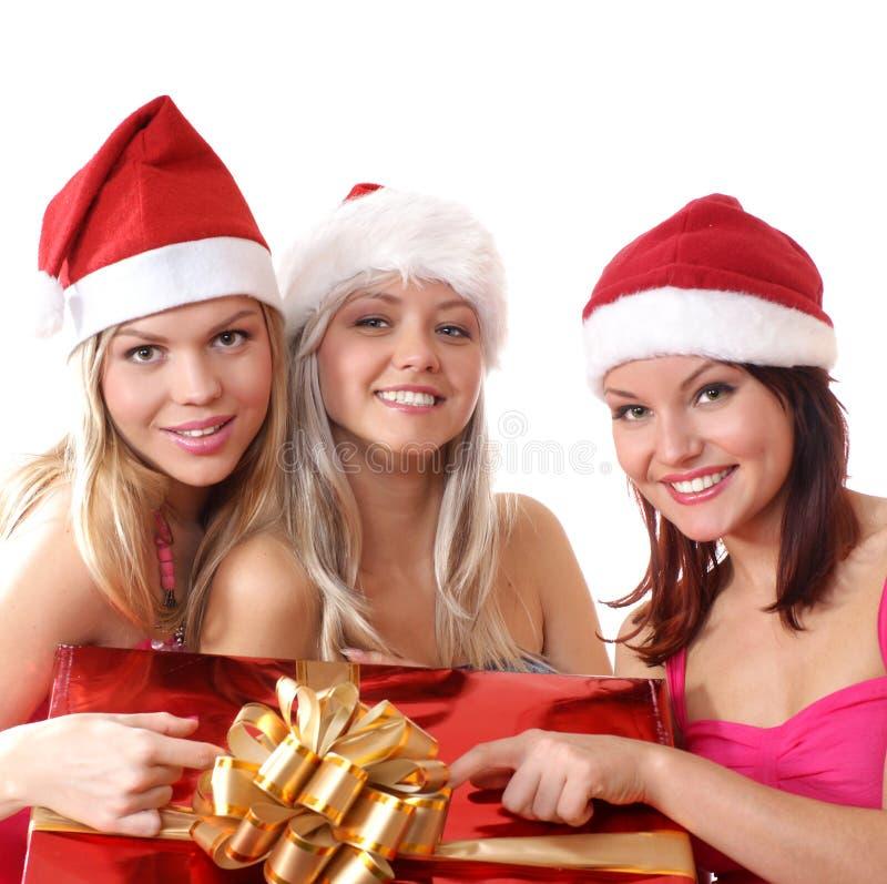 Tres chicas jóvenes están teniendo una fiesta de Navidad fotografía de archivo libre de regalías