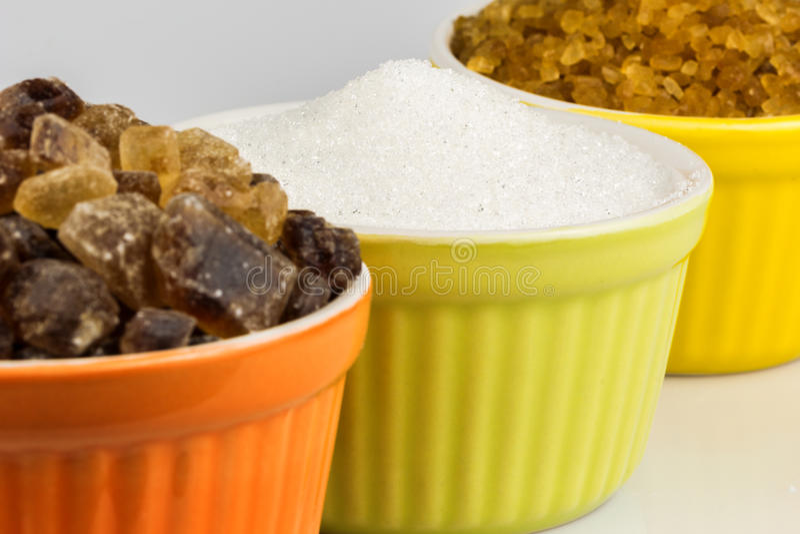 Tres clases de tazas del azúcar foto de archivo