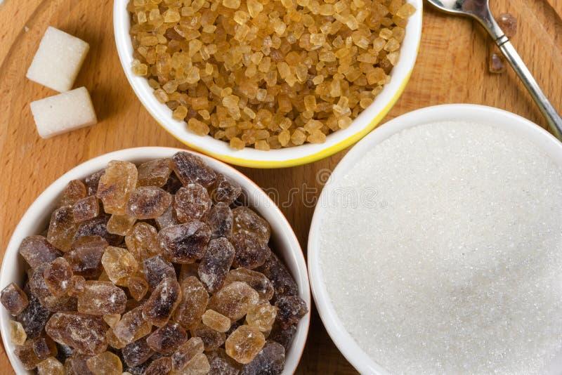 Tres clases de tazas del azúcar imagen de archivo