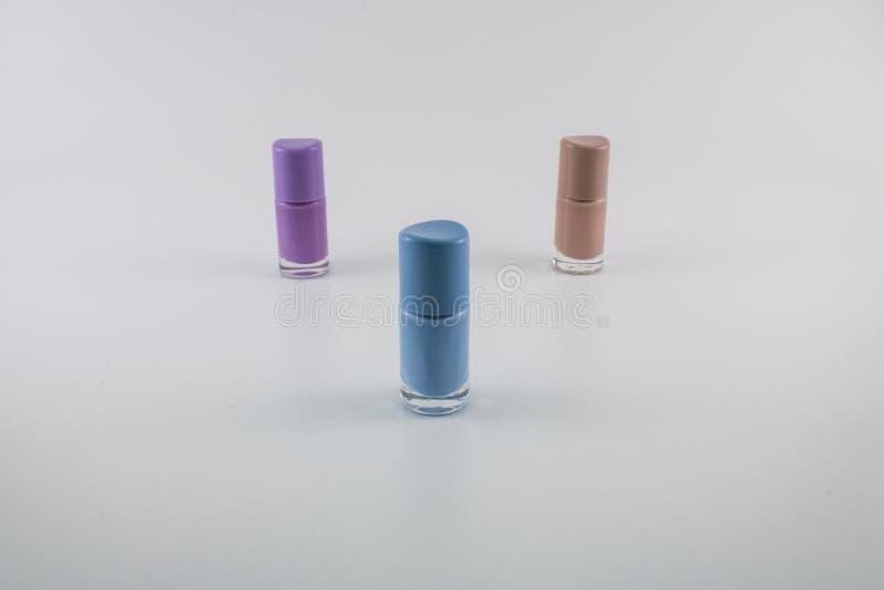 Tres colores del esmalte de u?as fotografía de archivo libre de regalías