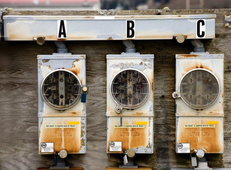 Tres contadores eléctricos fotografía de archivo libre de regalías