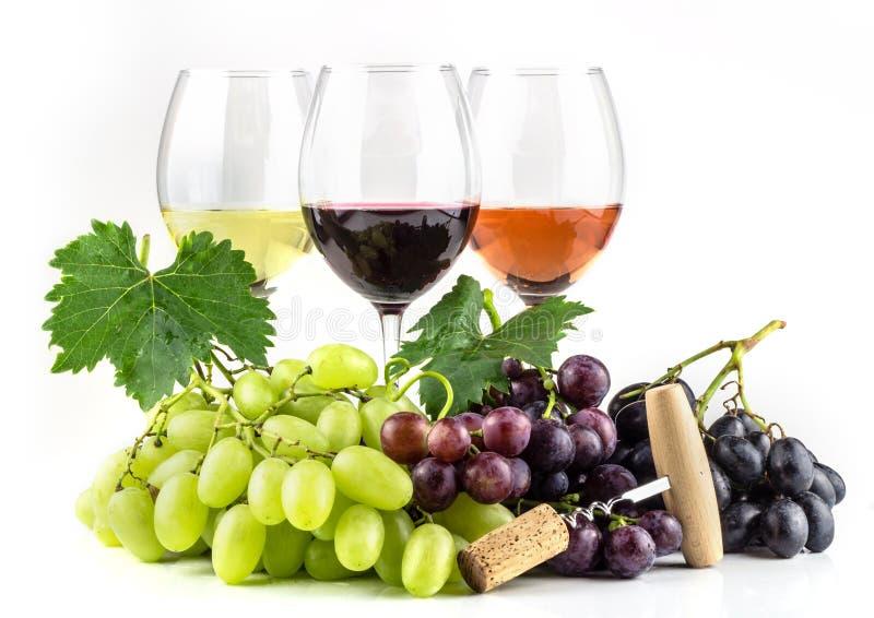 Tres copas con blanco, la rosa, y el vino rojo imagenes de archivo