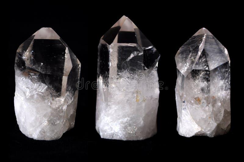 Tres cristales de cuarzo de la roca fotografía de archivo libre de regalías
