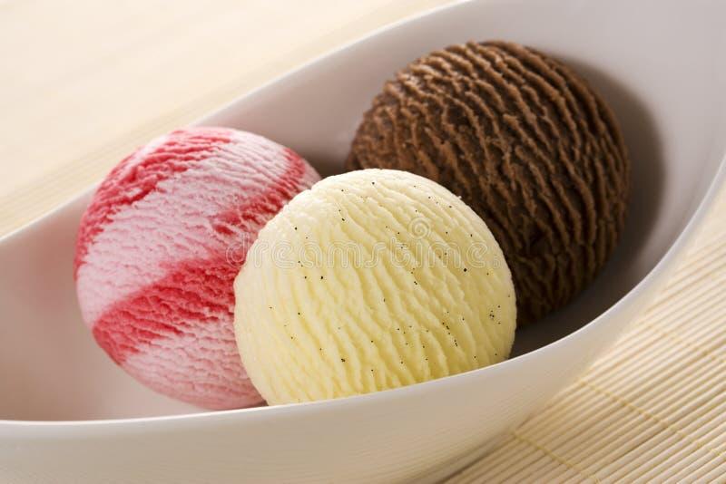 Tres cucharadas de helado foto de archivo libre de regalías