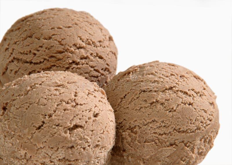 Tres cucharadas de helado de chocolate imágenes de archivo libres de regalías