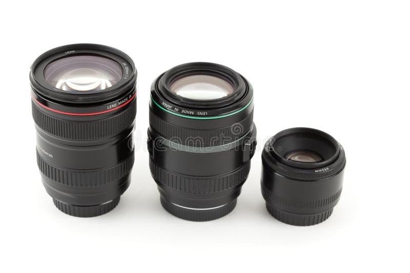 Tres de la lente a la cámara fijaron en fila. foto de archivo libre de regalías