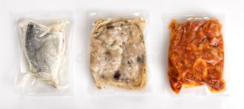 Tres diversas comidas sanas empaquetadas al vacío frescas imagen de archivo libre de regalías