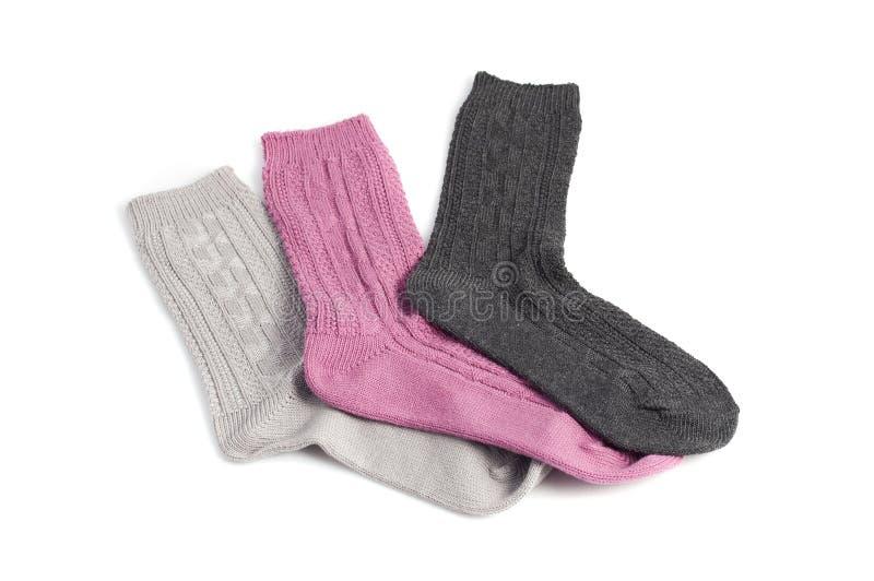 Tres diversos calcetines, colores de rosa, grises y negros fotografía de archivo