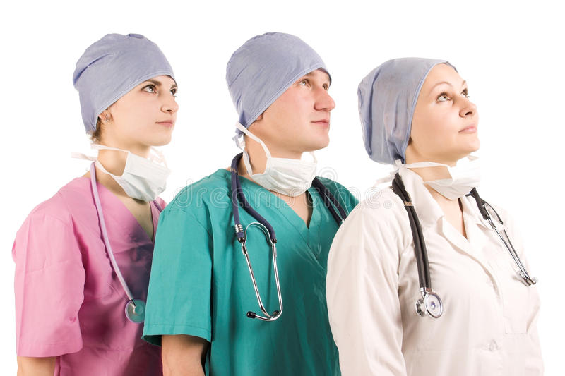 Tres doctores que miran para arriba fotografía de archivo libre de regalías