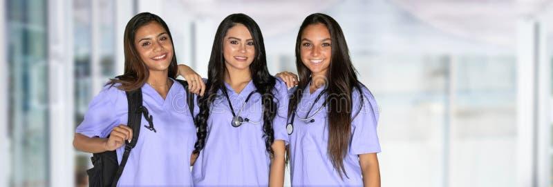 Tres estudiantes de cuidado imagen de archivo