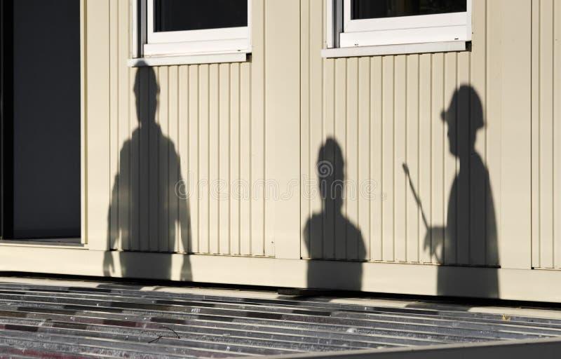 Tres figuras de la silueta foto de archivo