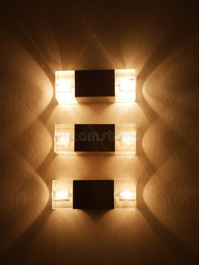 Tres filas de la lámpara de pared fotos de archivo libres de regalías