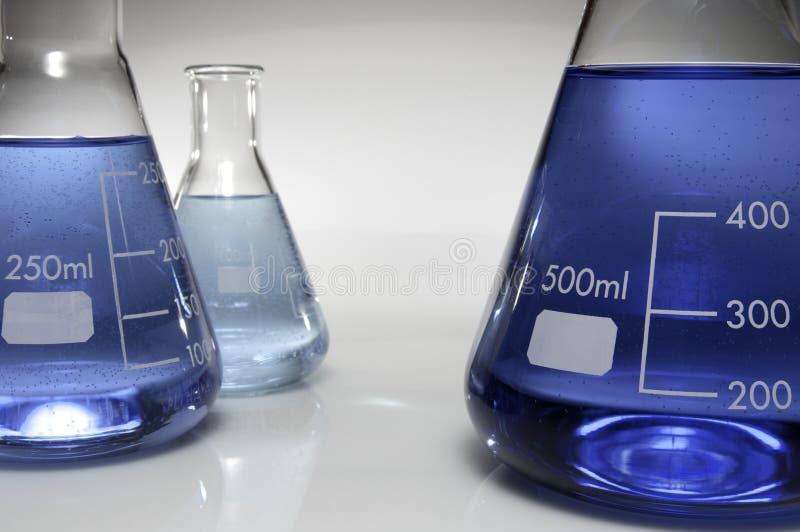 Tres frascos cónicos imagen de archivo libre de regalías