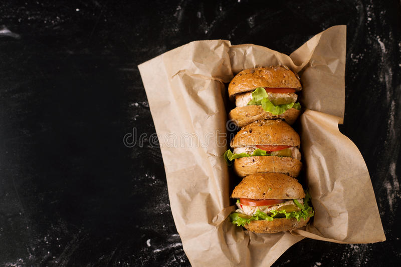 Tres hamburguesas fotografía de archivo