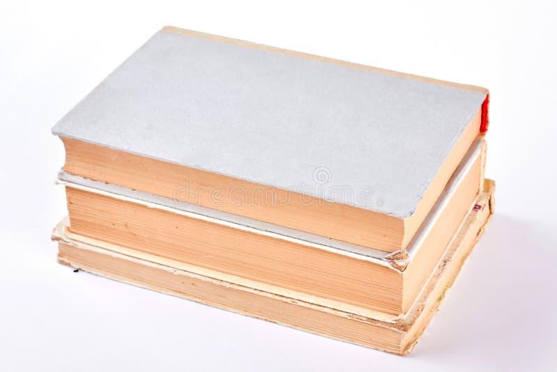 Tres libros viejos, fondo blanco imagen de archivo