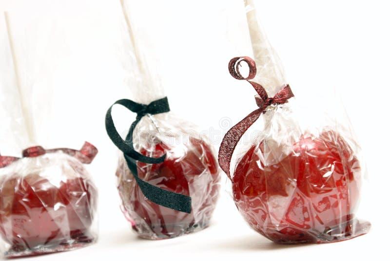 Tres manzanas de caramelo imágenes de archivo libres de regalías