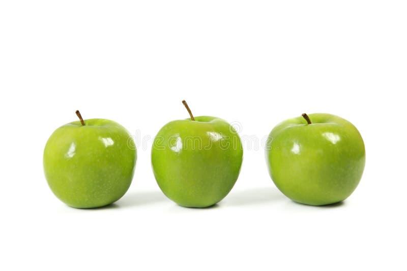 Tres manzanas verdes foto de archivo libre de regalías