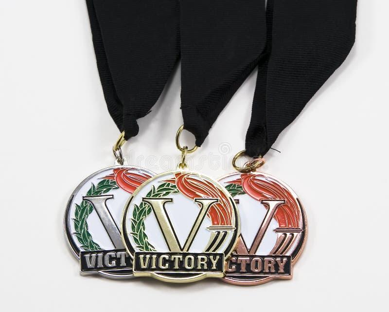 Tres medallas en cintas negras imagen de archivo libre de regalías