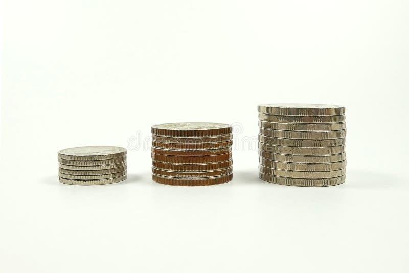 Tres monedas de las pilas aisladas en el fondo blanco fotos de archivo libres de regalías