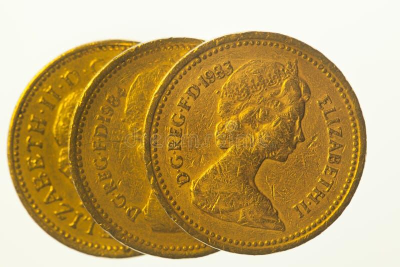 Tres monedas de una libra imagen de archivo