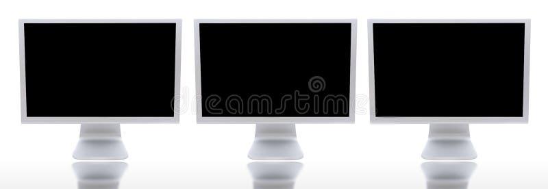 Tres monitores de ordenadores ilustración del vector