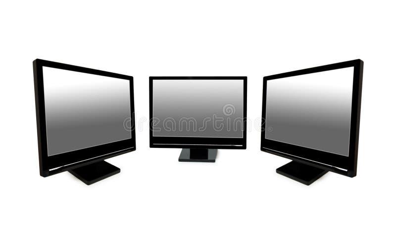 Tres monitores negros del lcd aislados en el blanco fotos de archivo