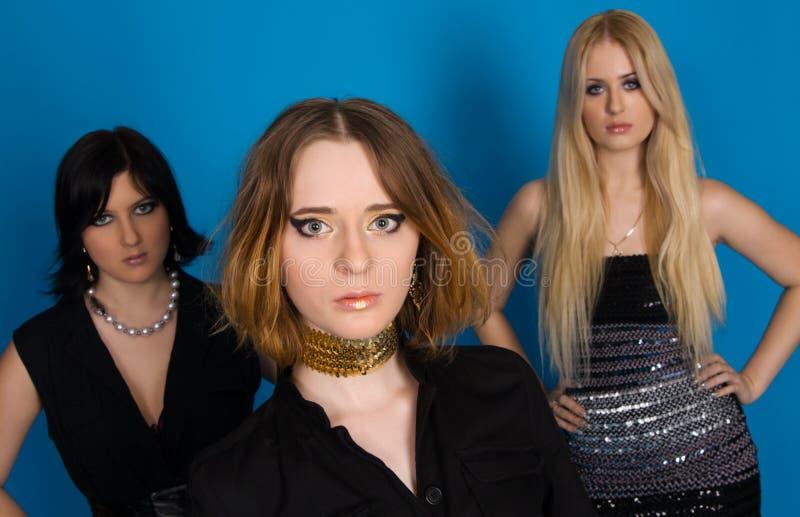Tres muchachas de moda foto de archivo