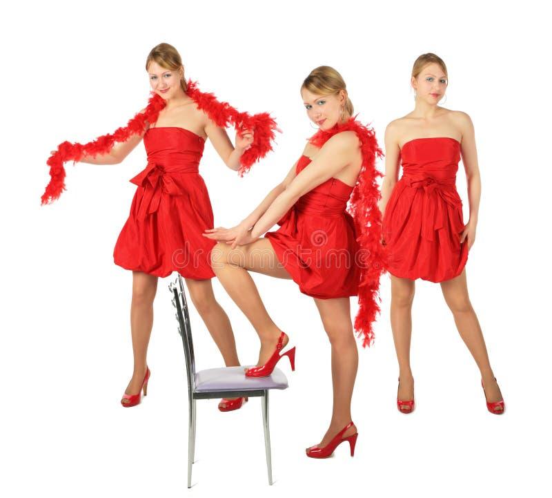 Tres muchachas rubias jovenes en la alineada roja, collage imagenes de archivo